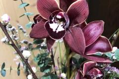 Blumenabonnement mit Cymbidien Detailaufnahme