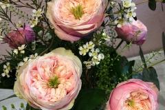 Blumenabonnement Detailaufnahme mit Rosen